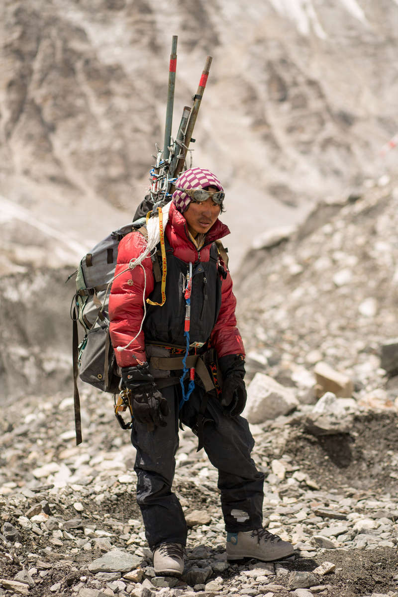 Sonam Dorji Sherpa a climbing Sherpa from Phortse working for IMG carries some of the last loads down from Everest at the end of the 2012 season.