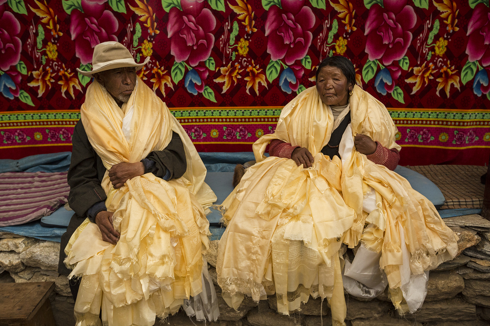 Nyima Doma's Family gives money and Katas to the monks overseeing the Dumji Festival.  Nyima nd her husband (Da Rita Sherpa) were supposed to be organizers for the festival this year but he died at Camp 3 on Everest of heart failure while working for IMG.  In his place his father and mother (Phu Dorji and Phura Yangji (mother) and Nyima's brother  (Ang Chuldim) are helping with the work.  It is an emotional day for the 4, as they are honored with Katas (honor scarves) from the community.