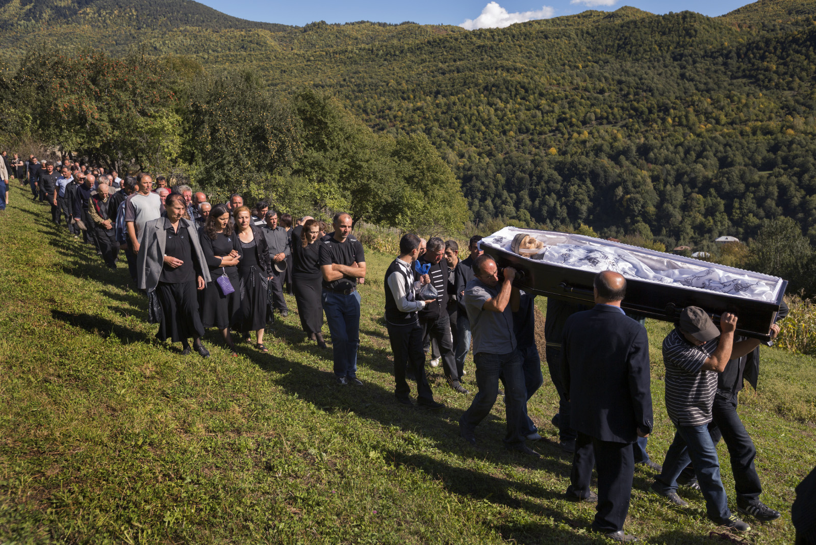 Funeral Procession and burial of Bikenti Khorguani, age 92, the last WWII veteran from Svanetia.