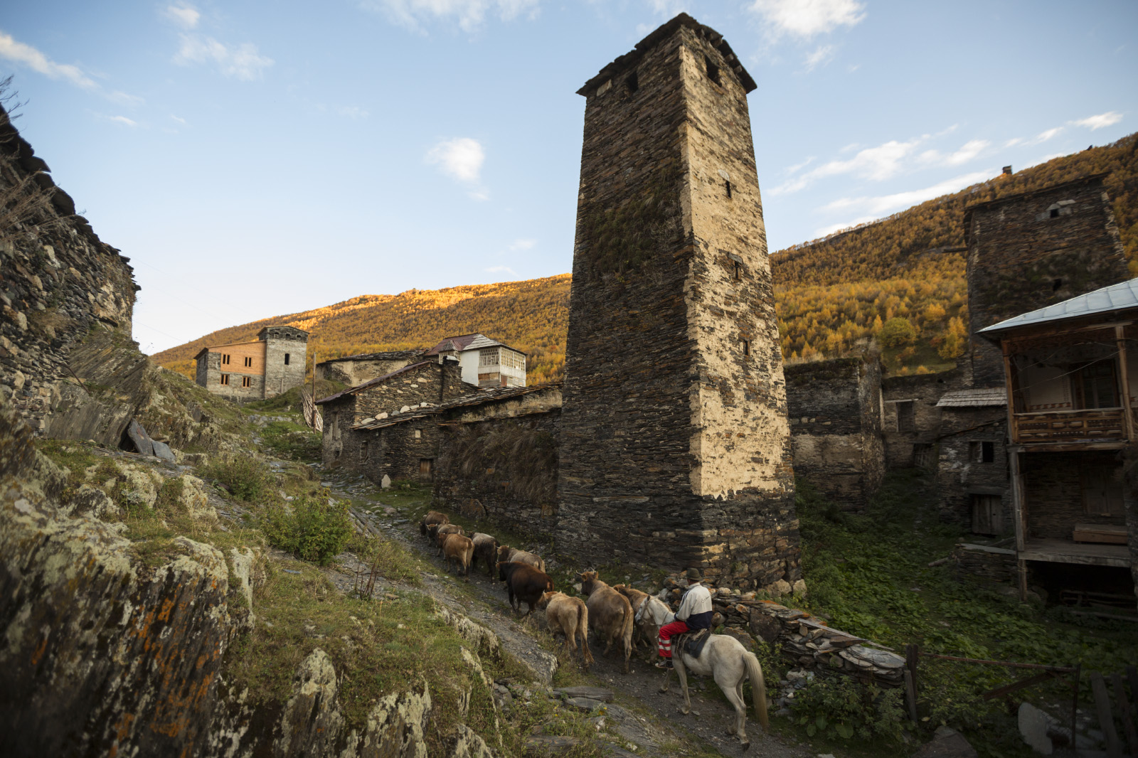 The village of Ushguli, Svanetia, Georgia.The Ushguli villages contain buildings that are part of the UNESCO Heritage site of Upper Svaneti.Altitude is 2,410 metres (7,910 ft).It is located at the foot of Shkhara, one of the highest Caucasian summits. About 70 families (about 200 people) live in the area, enough to support a small school. The area is snow-covered for 6 months of the year, and often the road to Mestia is impassable.Typical Svanetian protective towers are found throughout the village. The Ushguli Chapel located on a hilltop near the village dates back to the 12th century.