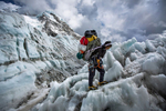 Climbing Sherpas return down the Khumbu Ice Fall after gathering the last gear at Camp 2.