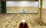 Two boys study during a class focused on memorizing the  Qu'ran at the Muslim Center of New York.
