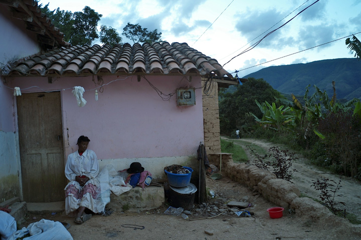 Ms. Vasquez relaxes outside her home after spending all day in the field.