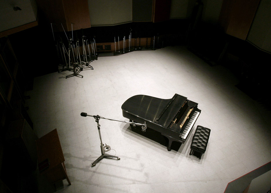 Nat King Cole's piano and Frank Sinatra's microphone are setup inside Studio B at Capitol Studios for recording.