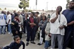 "Mourners wait to view the body of Crips co-founder Stanley ""Tookie"" Williams."