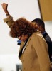 "Barbara Becnel raises her fist in support of her friend Stanley ""Tookie"" Williams during his funeral."