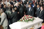 "The Rev. Jesse Jackson, third from right, and lawyer Tom Mesereau, Jr. (white haired - center) and others stand during a memorial service for  Stanley ""Tookie"" Williams."