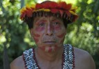 Arturo Kinin, an Awajun wearing warrior attire, works as a history teacher in the area. Kinin expressed disgust with the Peruvian government which he stated has not provided medical assistance or compensation to victims of a police attack on protesters. Local plants with healing properties are being used to treat gunshot wounds, according to Kinin.