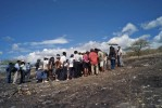 Amazonians gather at a memorial site whose grounds are charred as the result of a clash between indigenous natives, local migrants and the Peruvian national police.