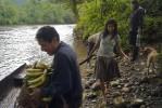 Awajun farmer and landowner Ricardo Apanu Nampin, 53, left, Ana Egampash Wakiu, 35, center, and Mirsa Wachapa, 40, prepare to cross the Chiriaco river with the day's harvest.