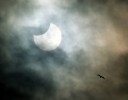 A partial solar eclipse occurs with the moon shielding 35 percent of the sun.