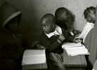 Ebsen Onyango, 4-1/2-yrs. old, chats with a classmate.