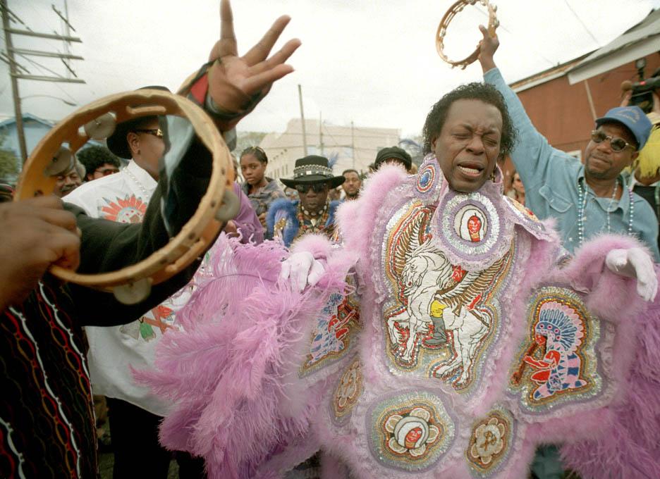 Bo Dollis, chief of the Wild Magnolias, struts on Mardi Gras Day.