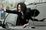 Michael Jackson waves to fans as he arrives at the Santa Barbara County courthouse for his child molestation trial.