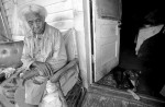 An elder relaxes on her porch. Mound Bayou is the country's oldest all-black municipality, founded by ex-slaves in 1887.