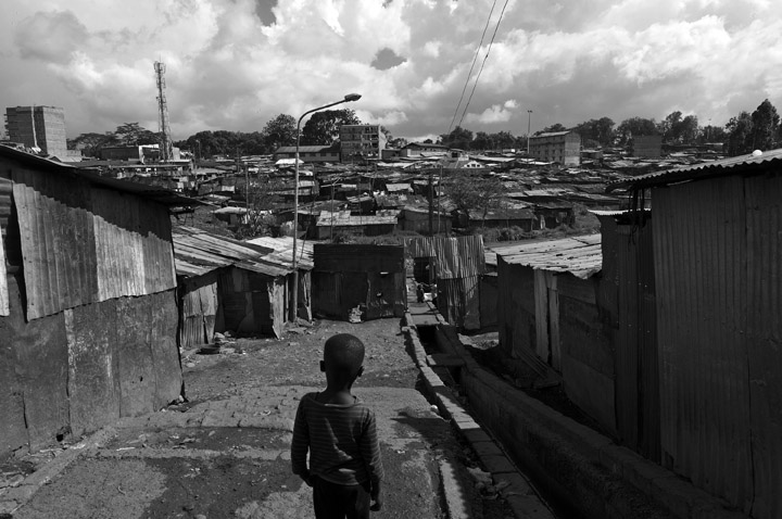 A young boy waits for friends in the Mathare slums, which are situated three miles east of the city's central business district.