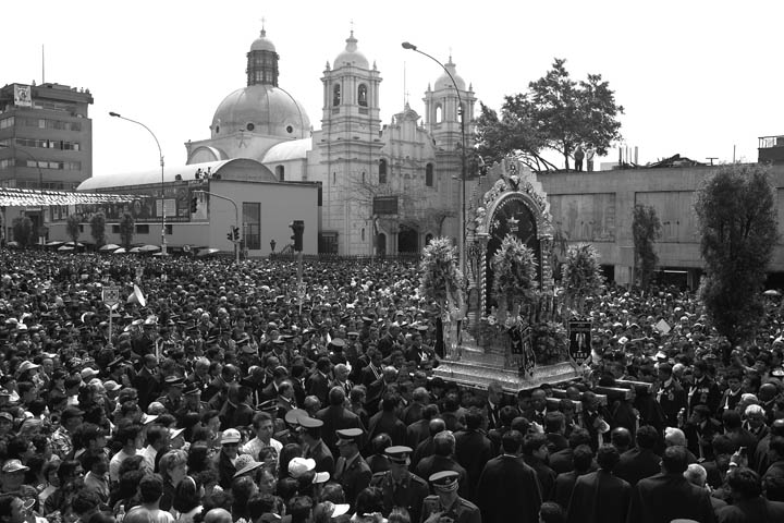 Thousands of Peruvians gather downtown to celebrate Senor de los Milagros (Our Lord of Miracles) outside the Church of Nazarenas.
