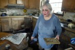 Phyllis Small salvages what  she can from her home which was destroyed by Hurricane Katrina.