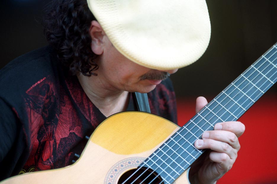 Carlos Santana sports his signature cap as he plays the New Orleans Jazz and Heritage Festival.