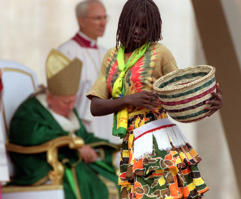 A Sundanese dancer performs for Pope John Paul II during a canonization ceremony.