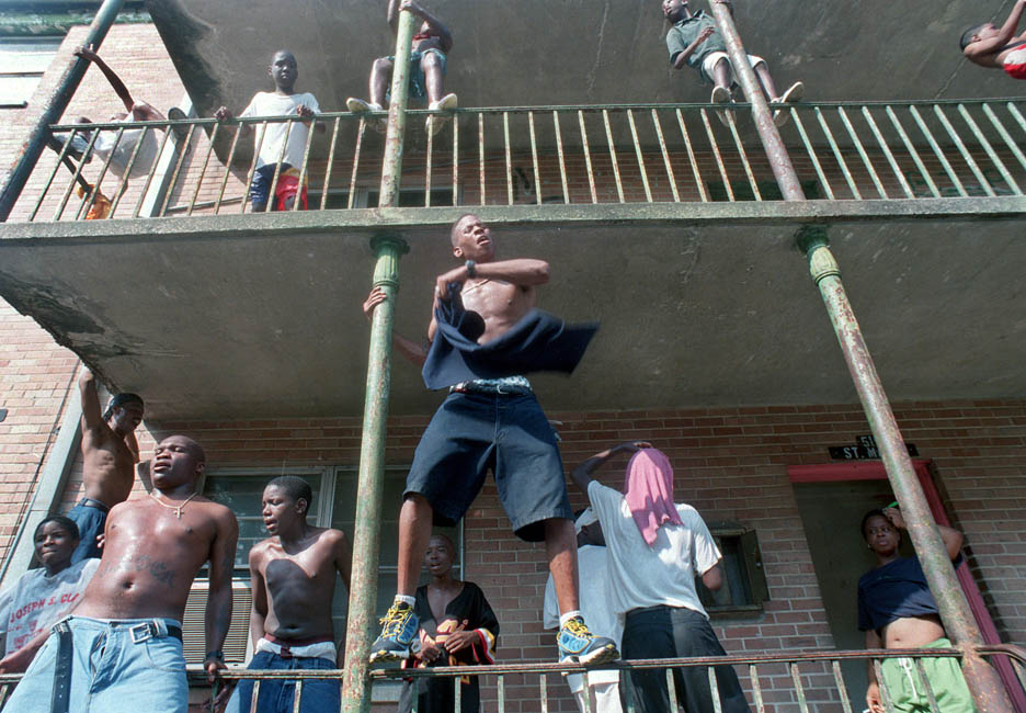 Rap artist/dancer Willie Puckett dances at a block party as fans chant {quote}Go Willie Puckett Go.{quote}