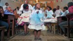 An Afro-Bolivian dance troupe performs for churchgoers during a celebration marking a religious festival ('Fiesta de San Benito').