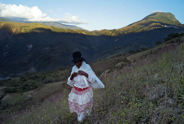 A coca farmer heads home in Tocana, a tiny community made up mostly of Afro-Bolivians in the lush Yungas Valley.