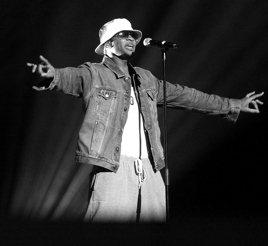 Usher rehearses his act for the American Music Awards.