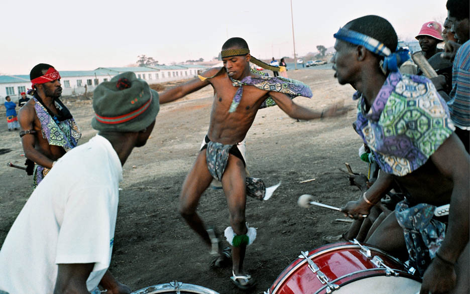 Several Zulus perform Mangwe, a traditional Zulu warrior dance.