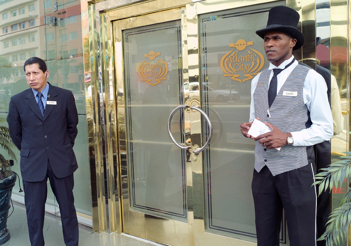 Claudio Martin, 37, right, works as a doorman at a casino. While race is used to exclude it is also used to symbolize servitude: Afro-Peruvian men are highly sought for jobs as doormen, under the belief that their skin color lends an aura of elegance to such occupations. Discrimination against blacks is strong hence job opportunities are limited.