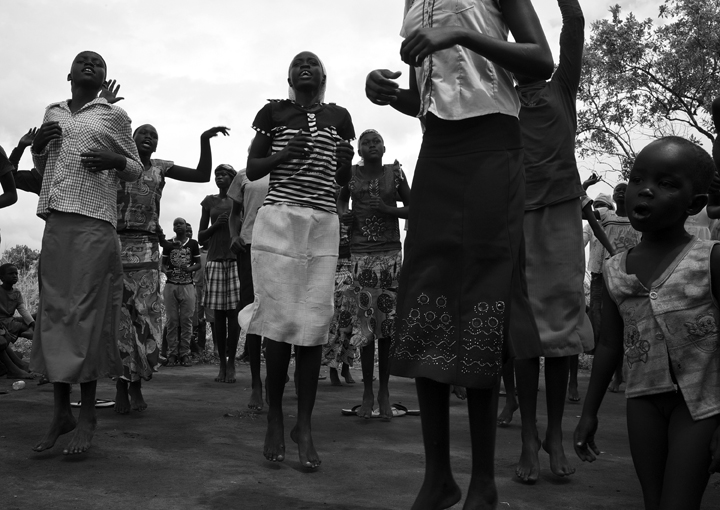Adjumani District - South Sudanese children (including a young girl with little clothing) who fled their country because of war, entertain themselves with a dance called {quote}Daluka.{quote}. In response to fighting which broke out in South Sudan in December 2013, thousands of South Sudanese refugees crossed the border at Nimule into northern Uganda. The fighting was between forces loyal to South Sudan president Salvar Kiir and his ex-vice president Rick Machar.