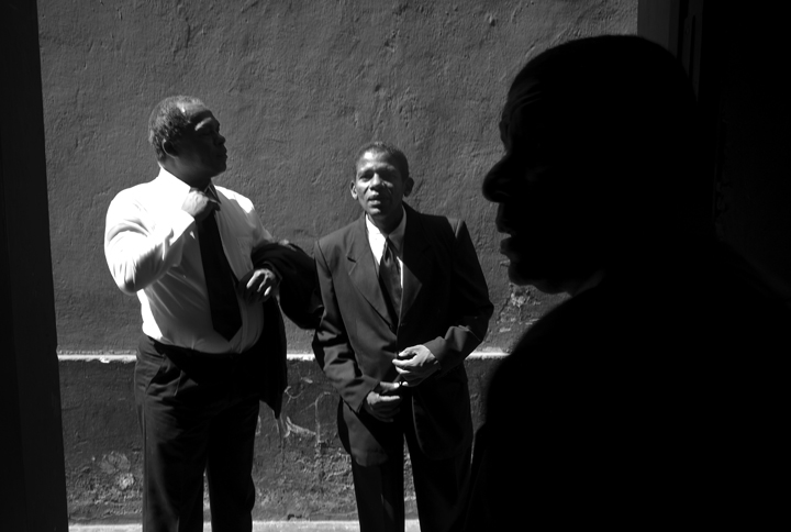Eduardo Castillo, right, his brother Victor Castillo, center, and Carlos Coychea prepare for a funeral assignment.