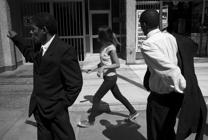 While waiting for a cab to take them to a funeral service Edwardo Alexander Rivas, right,tries to pick up a teenage girl as Victor Castillo chats with a colleague. During the wait Rivas, 24, spent the entire time trying to speak with young and mature women. {quote}I just love women, young or old it doesn't matter,{quote} explained Rivas.