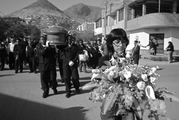 Afro-Peruvians carry the casket of Pedro Gregorio Moran Ramirez, 75, a wine and pisco maker, escorted by his family and friends.