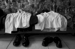 Clothes are set aside for two young Afro-Peruvian men who will work as camalenque during an afternoon funeral.