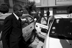 Several Afro-Peruvians take cabs to a camalenque assignment.
