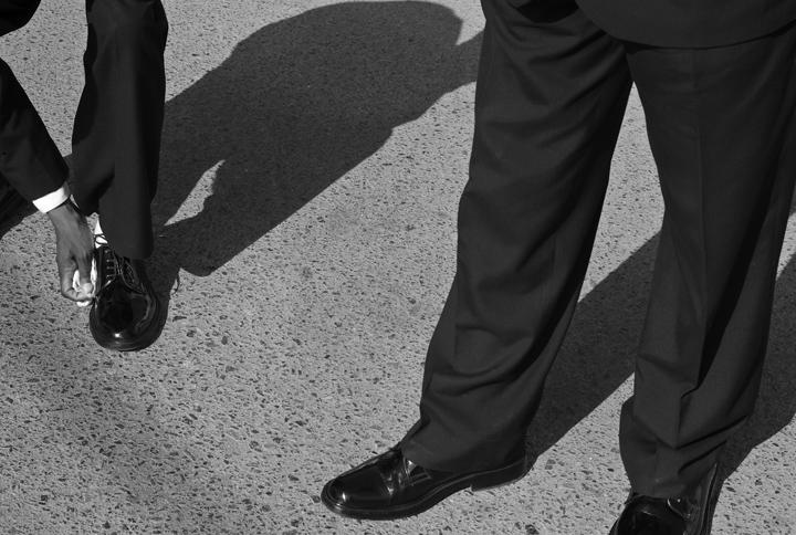 An Afro-Peruvian buffs his shoes.