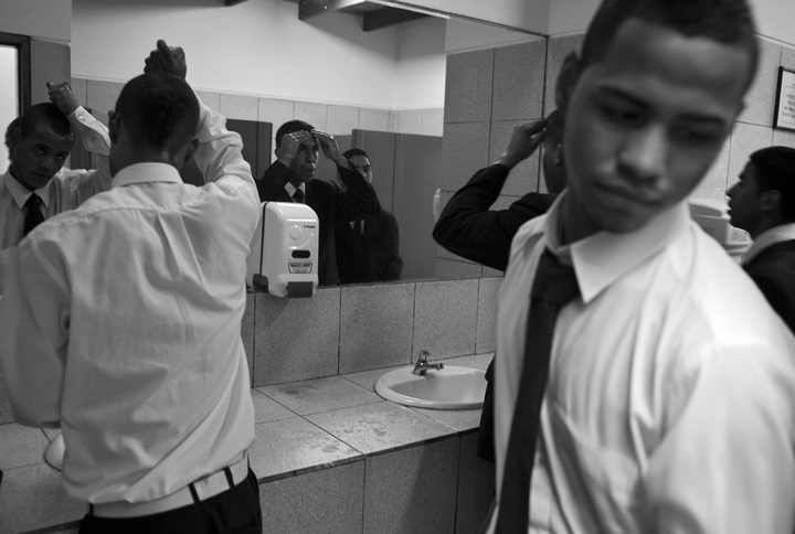 Afro-Peruvians use the bathroom at the cemetery to freshen-up as they prepare to go home.