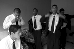 Several young men, who are related by family, prepare to work as camalenque.