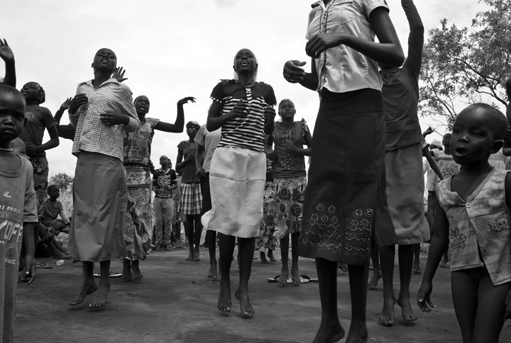 Young South Sudanese refugees, who fled their country because of war, entertain themselves with a dance called {quote}Daluka.{quote} Once a week they don their best clothing and gather for this social event; however, some of the children, such as the child on the right, have very few clothing items. In response to fighting which broke out in South Sudan in December 2013, thousands of South Sudanese refugees crossed the border at Nimule into northern Uganda. The fighting was between forces loyal to South Sudan president Salvar Kiir and his ex-vice president Rick Machar. The refugees have refused to return to South Sudan because of fear the fighting will resume.