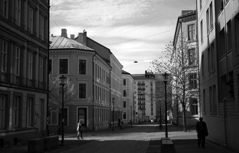 Pedestrians walk through a local street.