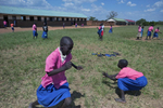 Students play during their lunch break at Acutomer Primary School. The school does not provide meals to the students, so because many of them live too far to go home for lunch they don't eat.