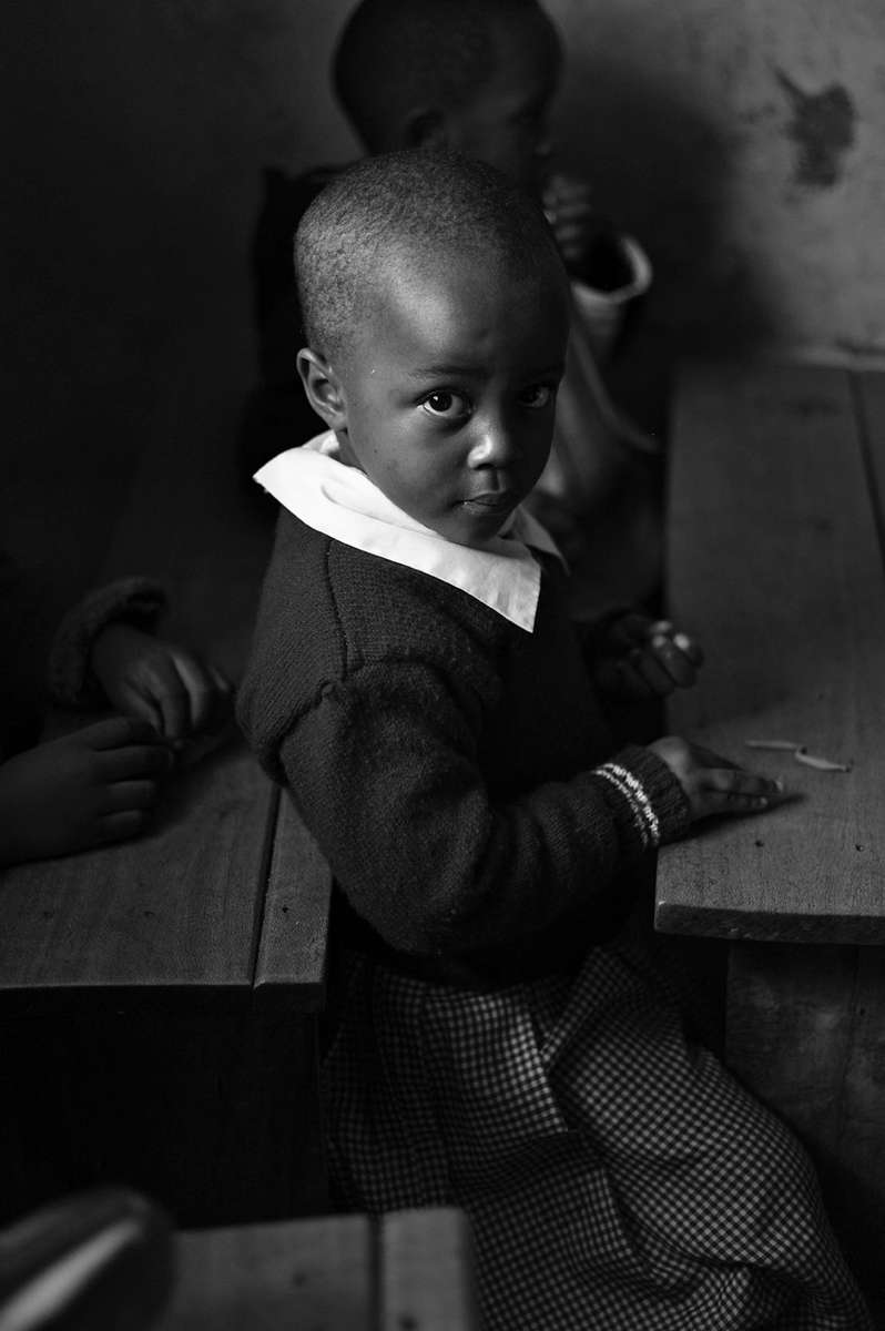 Ebsen Onyango, 4.5-yrs. old, sits at her desk during class.