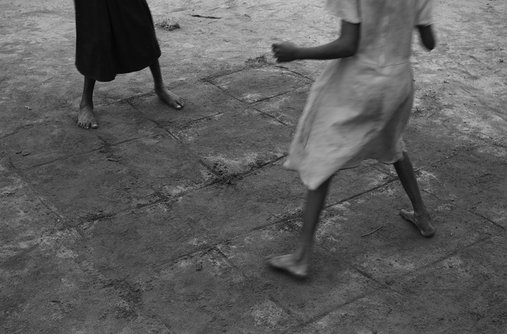 South Sudanese children play a game called {quote}Father or Mother,{quote}. which involves hopping around a grid.