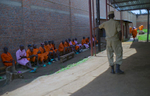 May 5, 2016 - Bugesera Prison - A guard watches over inmates convicted of genocide, who are waiting to discuss the atrocities they committed during the 1994 genocide.