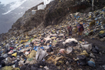 Gold scavengers called Pallaqueras (a vocational identity) walk through a pathway of garbage as they leave the mountains; Pallaqueras are women who scour loads of waste rock (ore discarded by miners) for gold. The horrendous sanitary conditions result from the unregulated disposal of garbage and human waste. The citizens of La Rinconada endure life in what has been called the dirtiest community at the highest altitude in the world: it has no running water, no sewage system and its grounds are contaminated by mercury used to separate rock from gold.