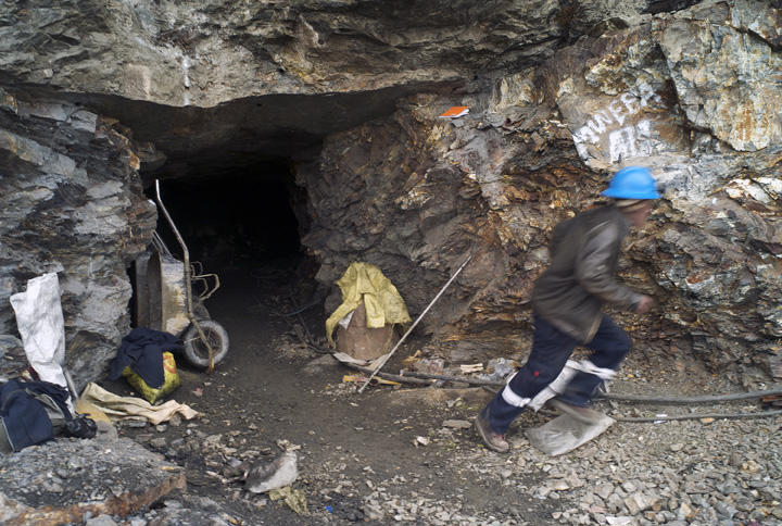 A miner rushes to check an air-supply machine.