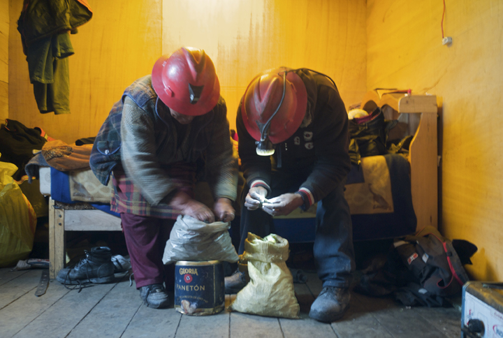 Martin Luque Vargas, 40, right, and his mother Filicitas Luque Vargas, 58, examine a sack of ore for gold before heading into town to make a sale. Martin moved his three children and his mother to the area in July 2008 after he lost his job - because of the recession - as a traffic controller in a nearby district.