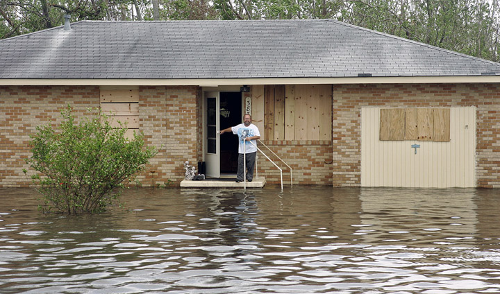 September 24, 2005 - Jean Lafitte, Louisiana - A stranded homeowner shouts to a passing military vehicle that he wants to be evacuated.