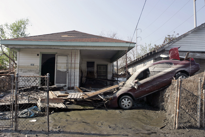 September 14, 2005 - New Orleans, Louisiana -  Homes and vehicles were heavily damaged in this Ninth Ward neighborhood.